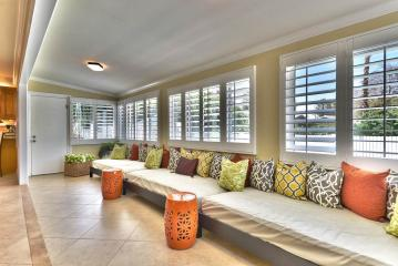 Sunroom with 3 daybeds for reading, relaxing, napping, or extra guests